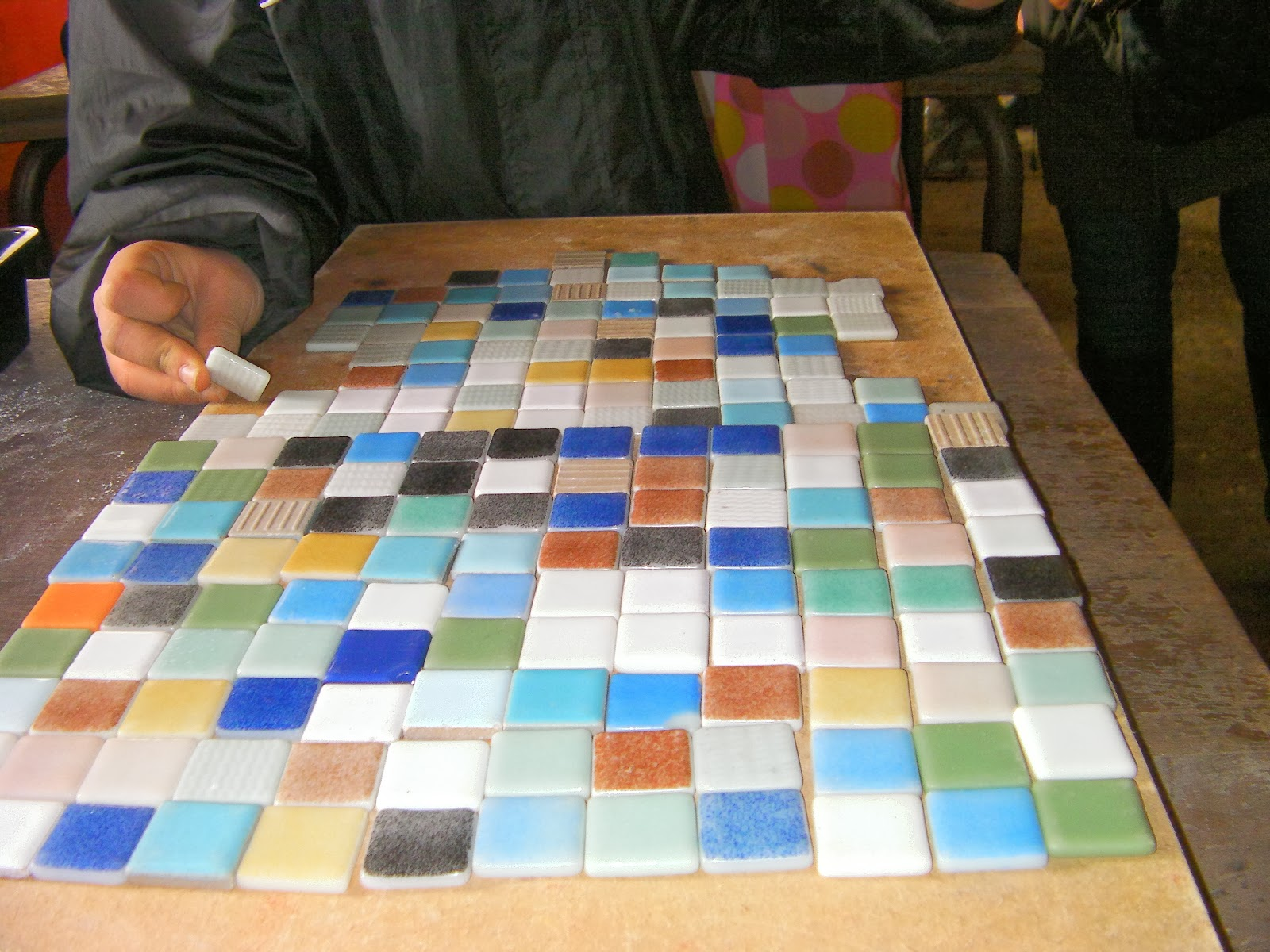 home made mosaic with little tiles on school field trip