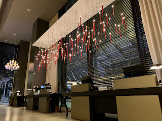 Candle light installation above the reception desk, JW Marriott Singapore Beach Road, 2021