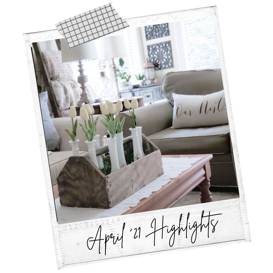 Springtime living room decorating with tulips, woods, and whites