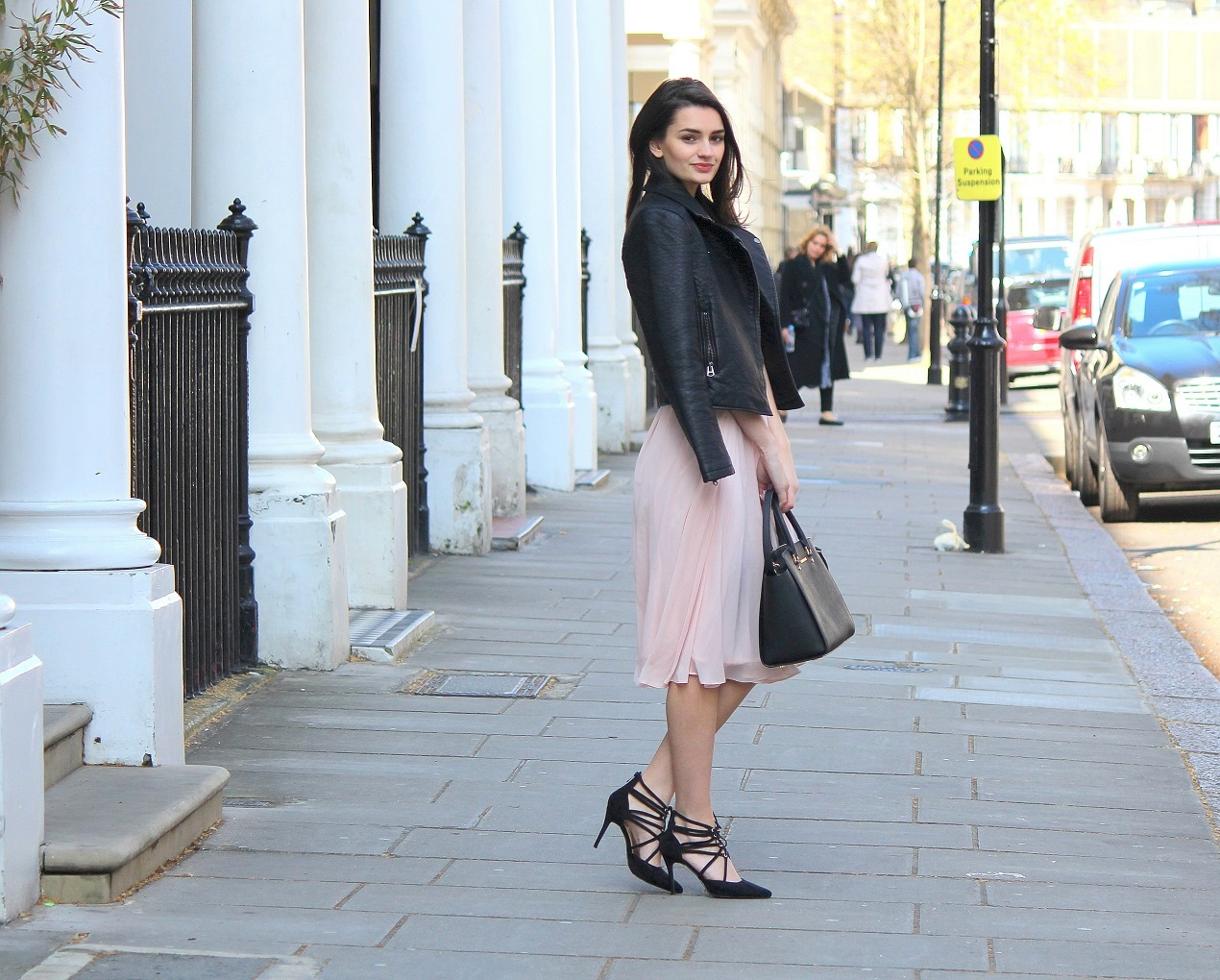 peexo fashion wearing leather jacket tshirt midi skirt and lace up heels