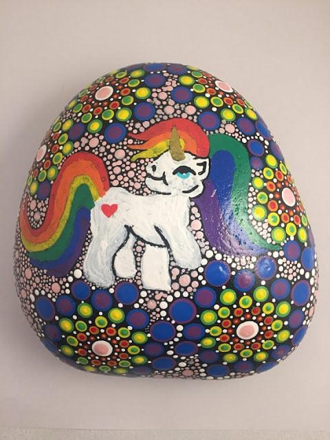 Painted rainbow unicorn and dot rock