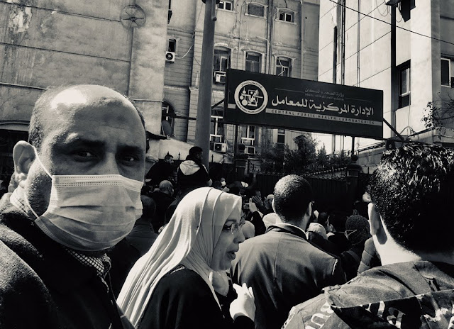 Standing in front of the Central Lab in Downtown Cairo  by amazing Roger Anis