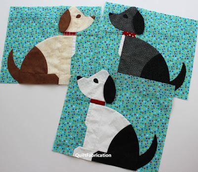 three different colored dog quilt blocks
