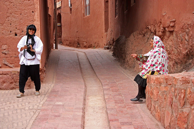A local woman in an alley in Abyaneh village.