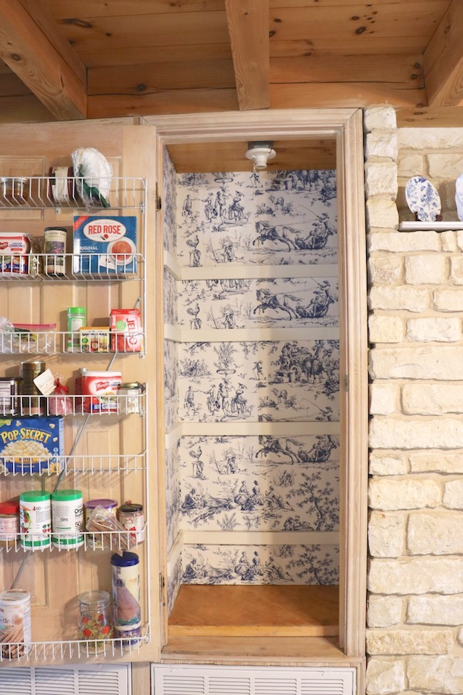 French Country Pantry Makeover with Seasons Toile Wallpaper and wire shelves on pantry door