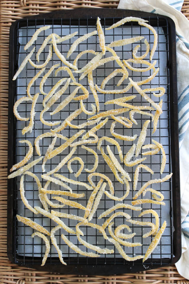 Making Candied Lemon Peel is a way to practice the 'waste not, want not way' of life by transforming the lemon peel you would normally discard into an irresistible sweet snack!  #feastndevour