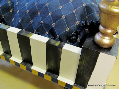 striped edges on painted dog bed with finials