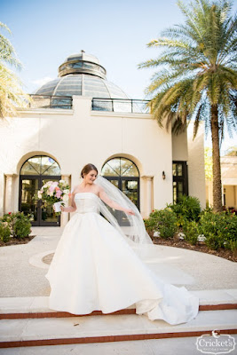 bride on stairs at Alfond Inn