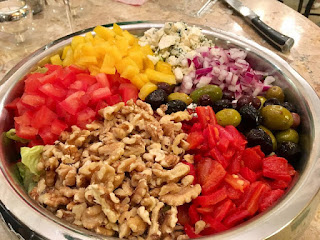 Incredible salad with nuts, olives, red peppers, onions, etc.