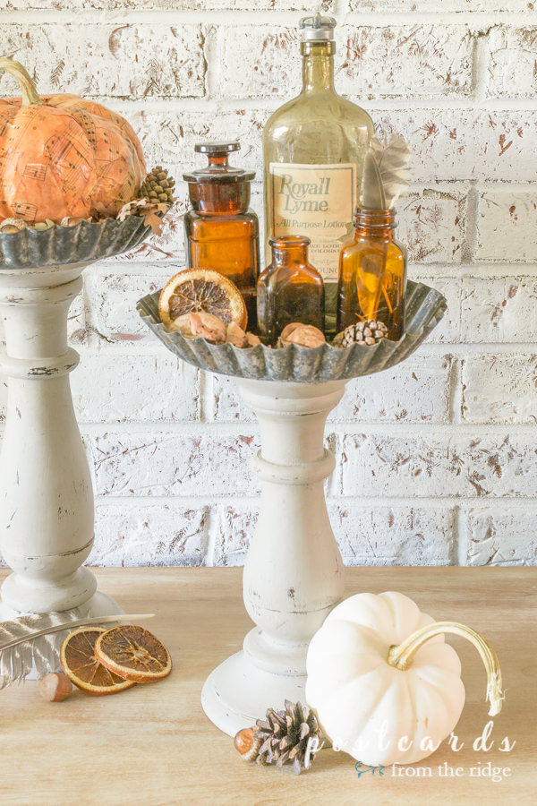 fall decor on diy pedestal stands made with wooden candleholders and tart pans