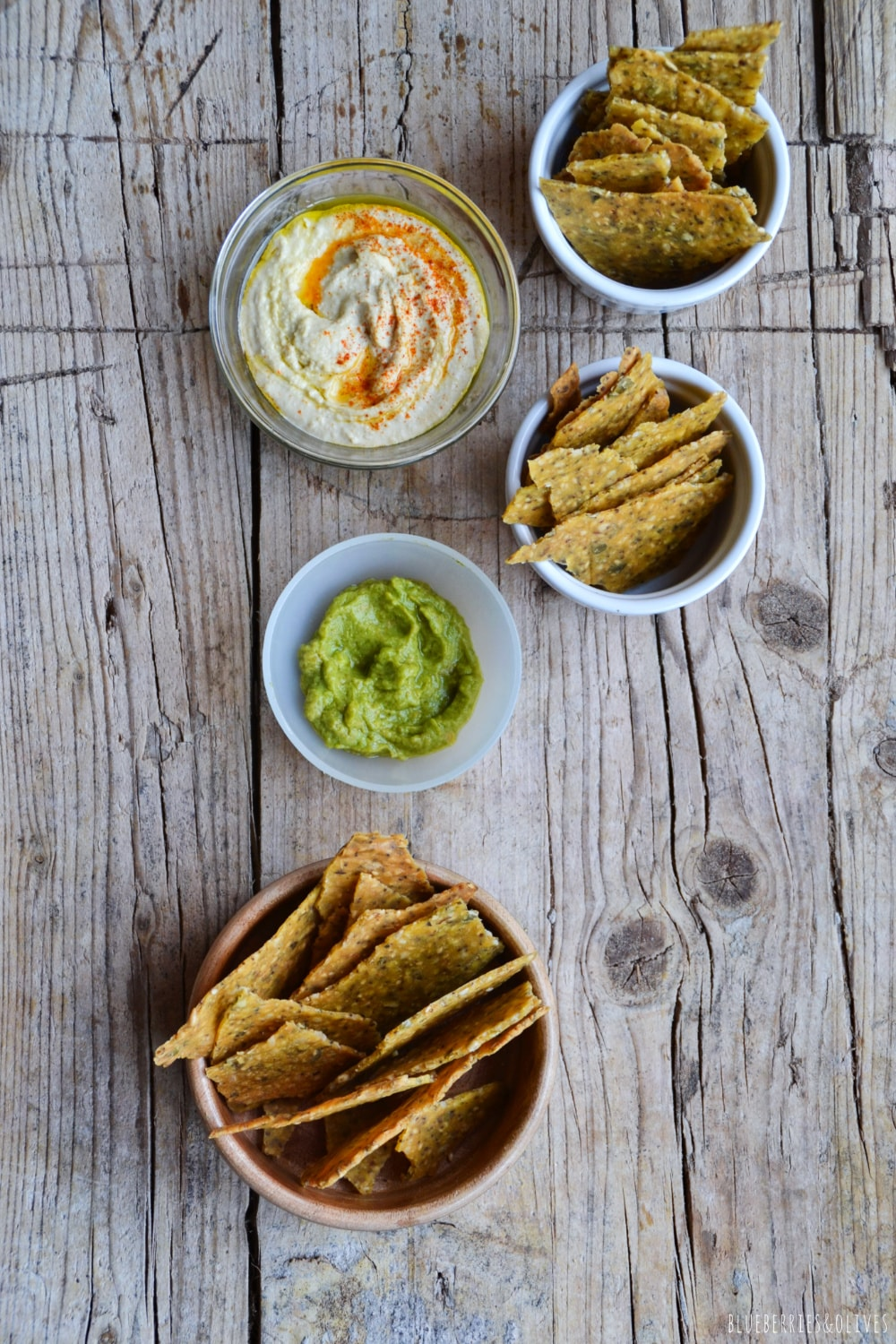 CORN CRACKERS WITH SOME DIPPING SAUCES, OLD WOOD BACKGROUND