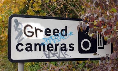 Greed cameras sign