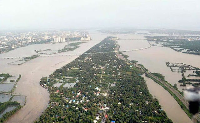 Kerala floods updates: Narendra Modi reaches Thiruvananthapuram, will take aerial survey of state tomorrow | Helpline no for kerla flood