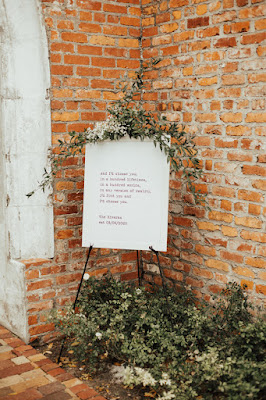 welcome sign with greenery decor