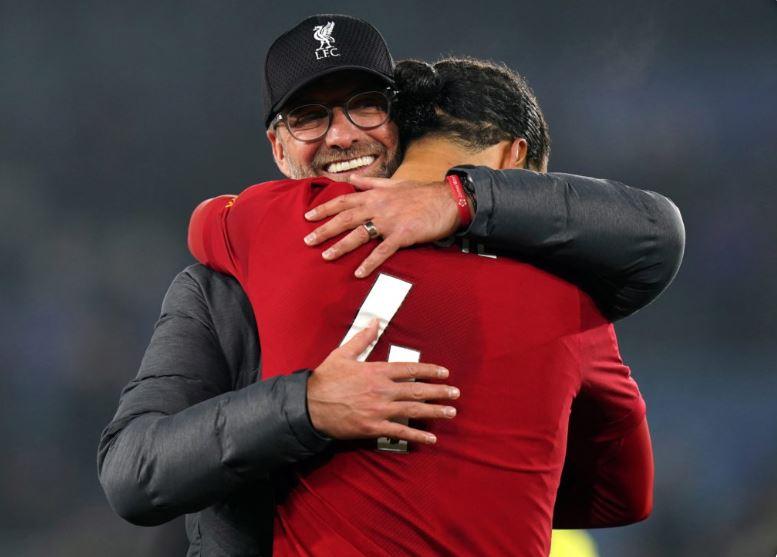 Liverpool coach Jurgen Klopp celebrates with Virgil Van Dijk