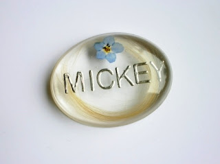 Personalised brooch containing a lock of hair