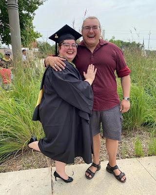 Graduation photo of woman with husband