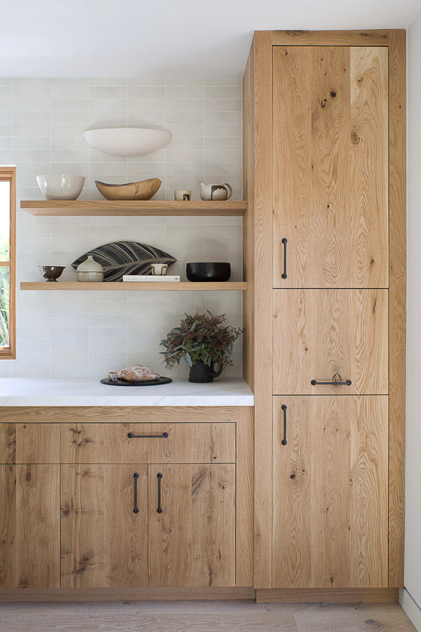 kitchen with open shelves and natural wood cabinets