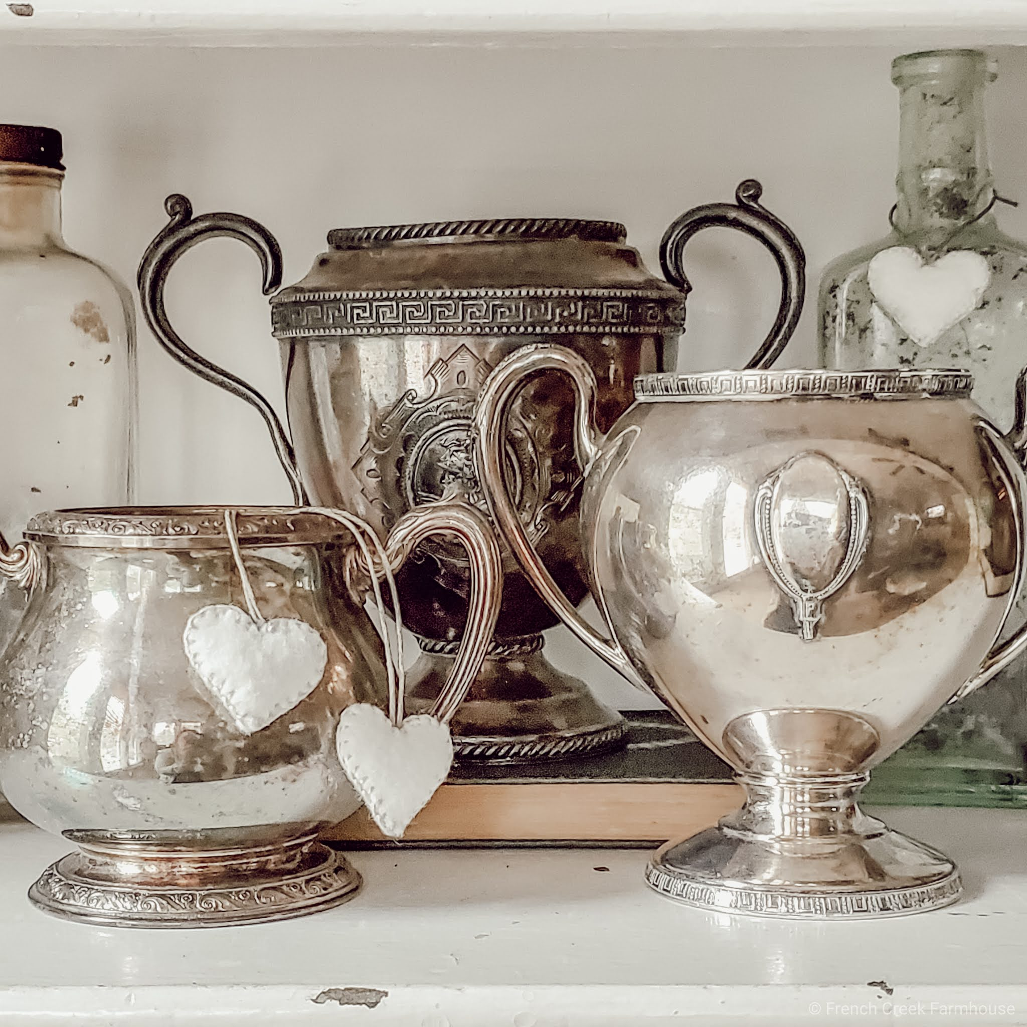 A collection of vintage loving cup trophies