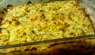 Macaroni casserole topped with mashed potatoes