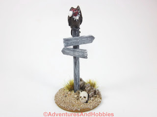 Vulture sitting atop sign post for 25-28mm scale miniature wargaming UniversalTerrain.com