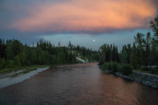 Looking south at moonrise over North Fork Flathead River at Polebridge