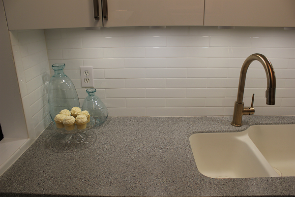 Delta Trinsic faucet with white backsplash