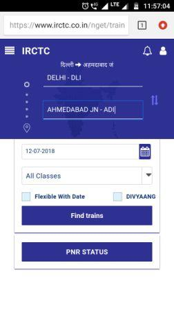 Picture of IRCTC home page on mobile phone with train enquiry box
