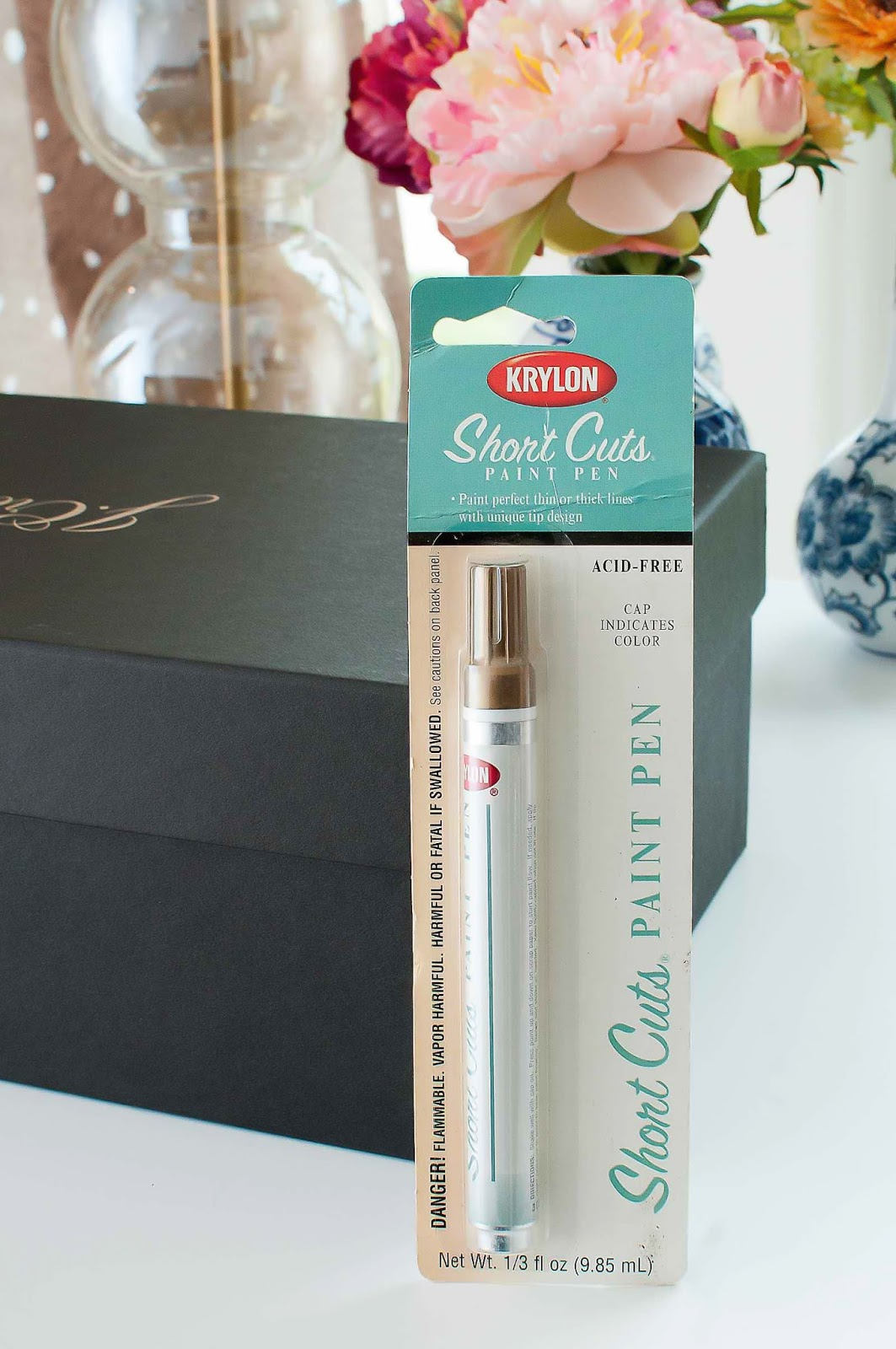 Turn a shoebox into a trendy storage box for your home office with a gold leafing pen.