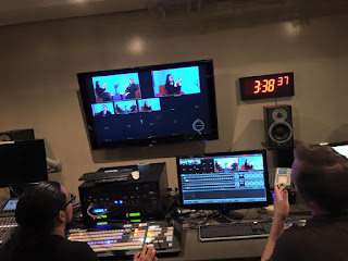 "We see banks of monitors and the Director's desks as ""Blindside Fresno"" is recorded in the television studio"