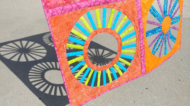 Open weaving circle quilt using Island Batik fabrics