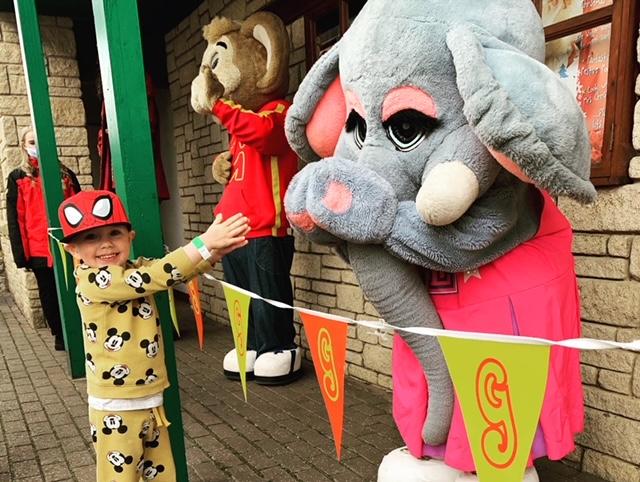 Little boy with Ellie Elephant at Gulliver's Land