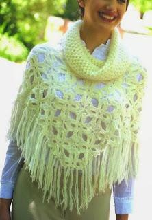http://patronesparacrochet.blogspot.com.es/2014/02/poncho-crochet-flor-4-petalos.html