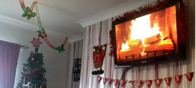 The fireplace on the TV