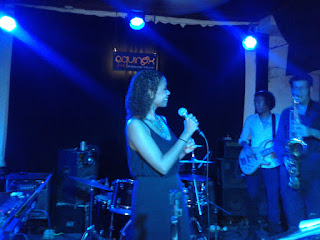 Color photo of Rhiannon Johnson on stage at Equinox - Phnom Penh, Cambodia
