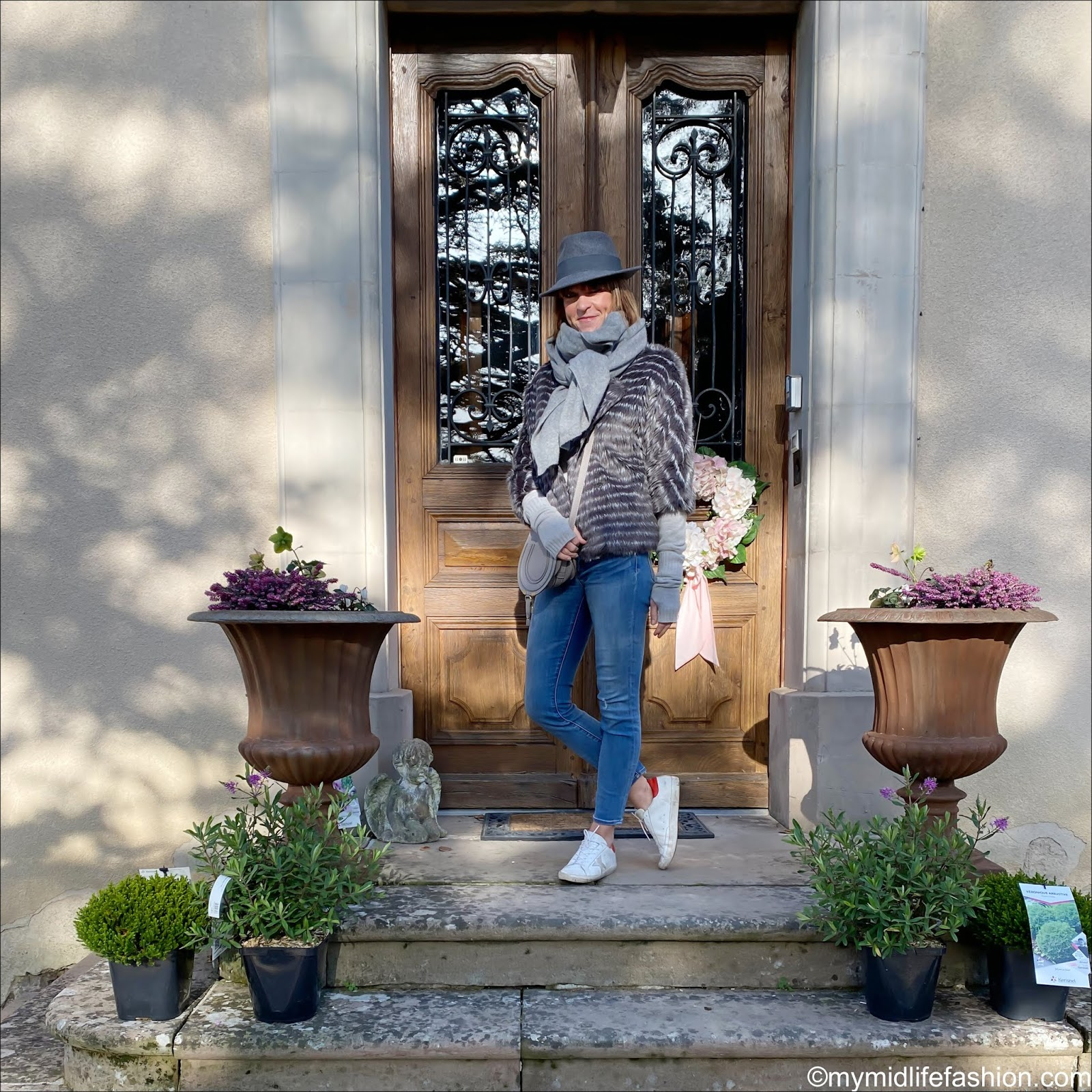 my midlife fashion, tibi faux fur coat, Marks and Spencer pure cashmere roll neck jumper, j crew 8 inch toothpick skinny jeans, golden goose superstar low top leather trainers, Chloe marcie small cross body bag, panaizza felt fedora hat, hush cashmere fingerless gloves