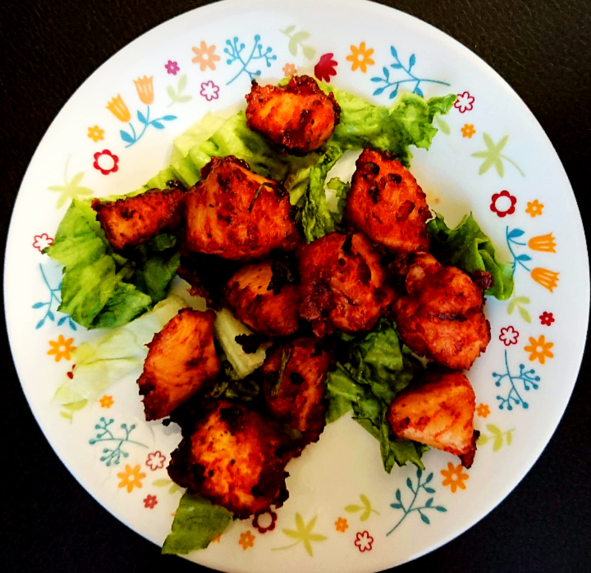 easy chicken pakoras on a bed of lettuce