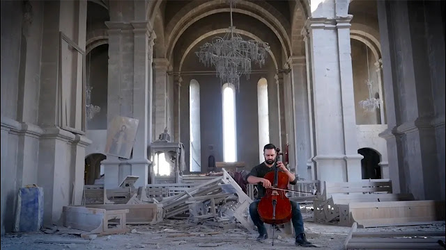 Sevak Avanesyan in the recently bombed Ghazanchetsots Cathedral in Shushi (Artsakh)