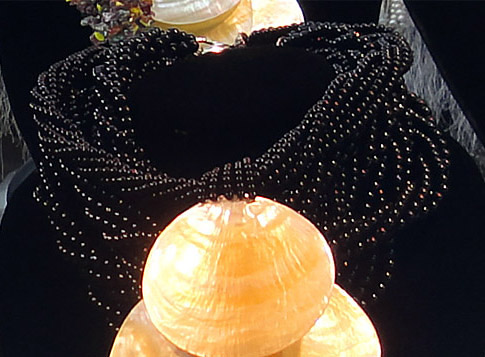black jade beaded necklace and mother of pearl pendant in a bogyoke market shop