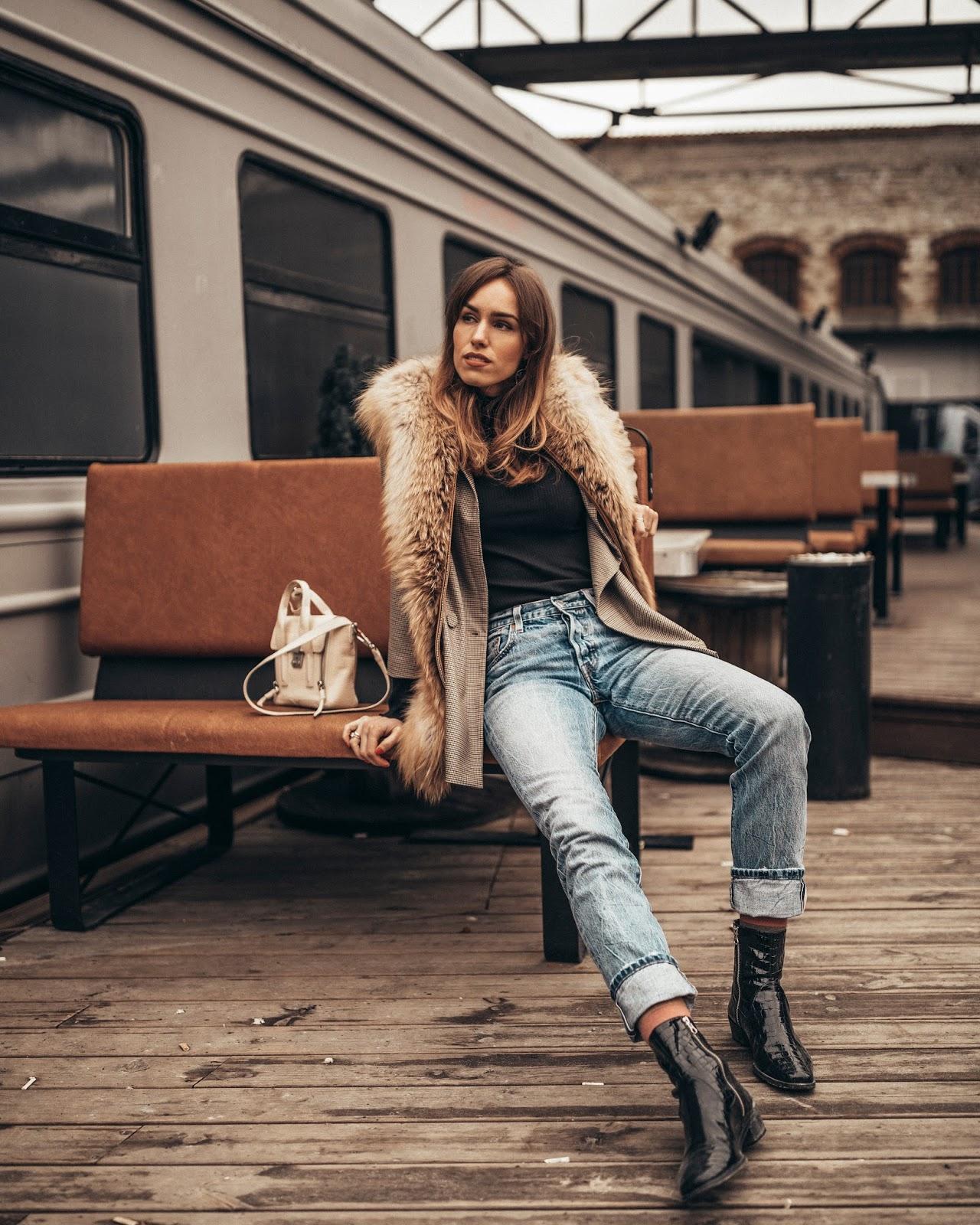 fur vest over blazer outfit minimalist