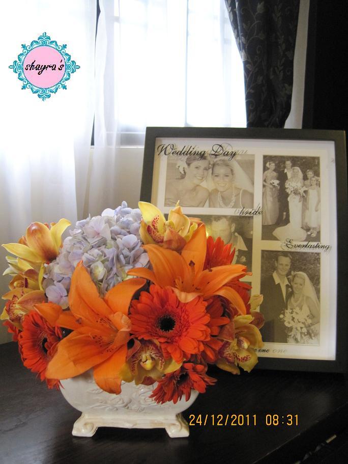 Flora By Shayra Orange Blue Flower Arrangements