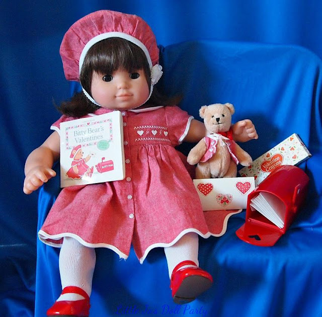 Bitty Baby Twin Dressed in a Valentine's Day outfit.