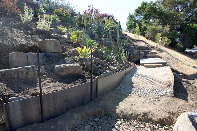 Path being built in a dry garden