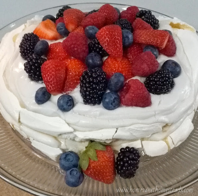 Summer Berries Pavlova Cake - Home Sweet Homestead #SummerDessertWeek Crispy on the outside, marshmallow-y soft on the inside meringue, coconut whipped cream, and fresh summer berries come together to make a deliciously beautiful dessert, that couldn't be easier to make!