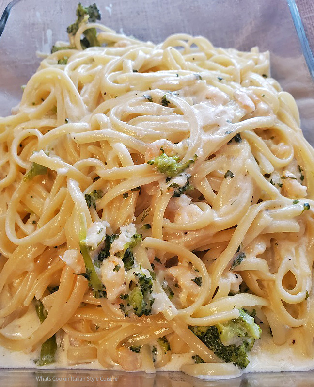 this is linguine pasta with shrimp and broccoli in alfredo sauce