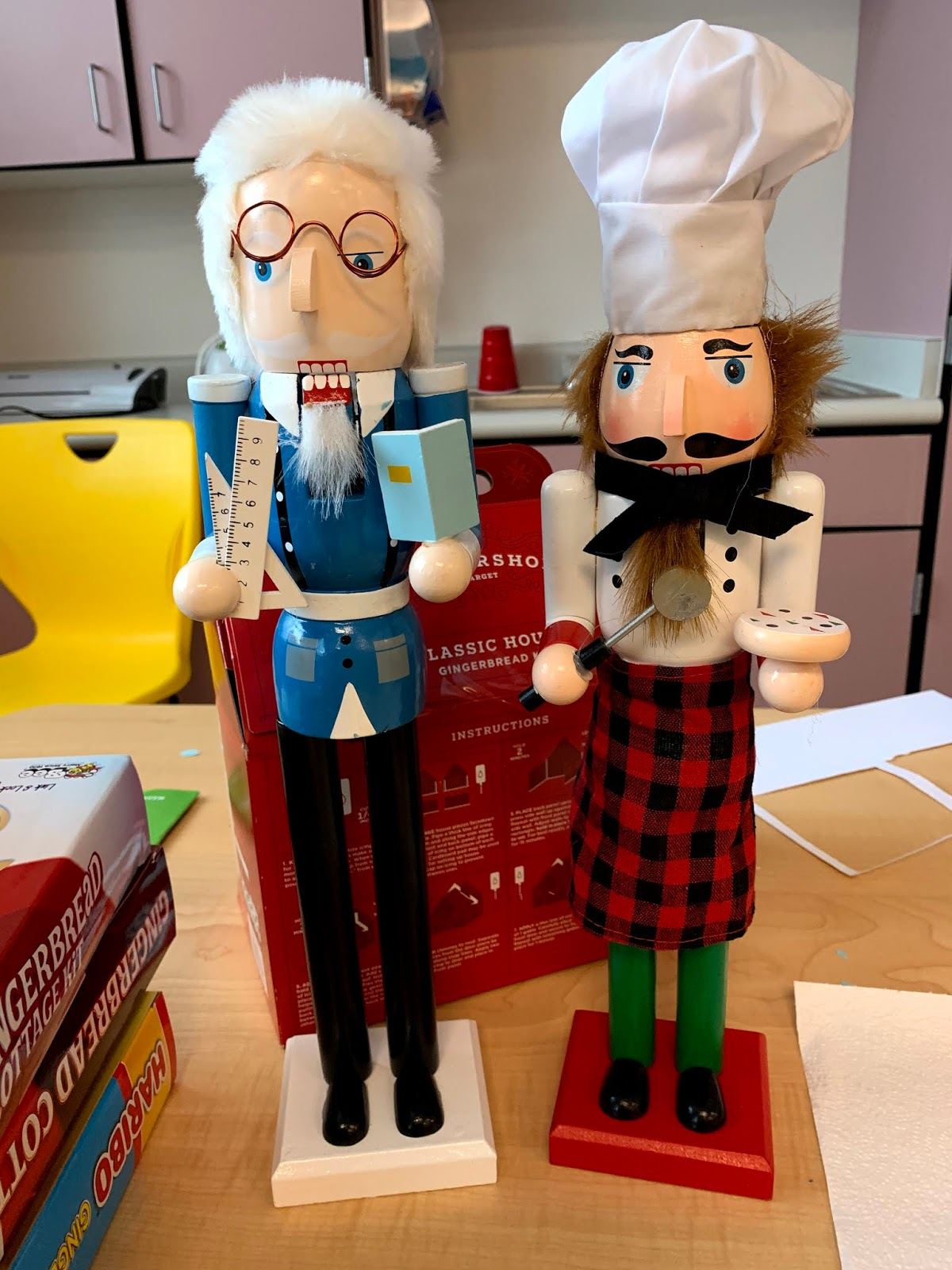 A professor and pizza chef Nutrcracker dolls