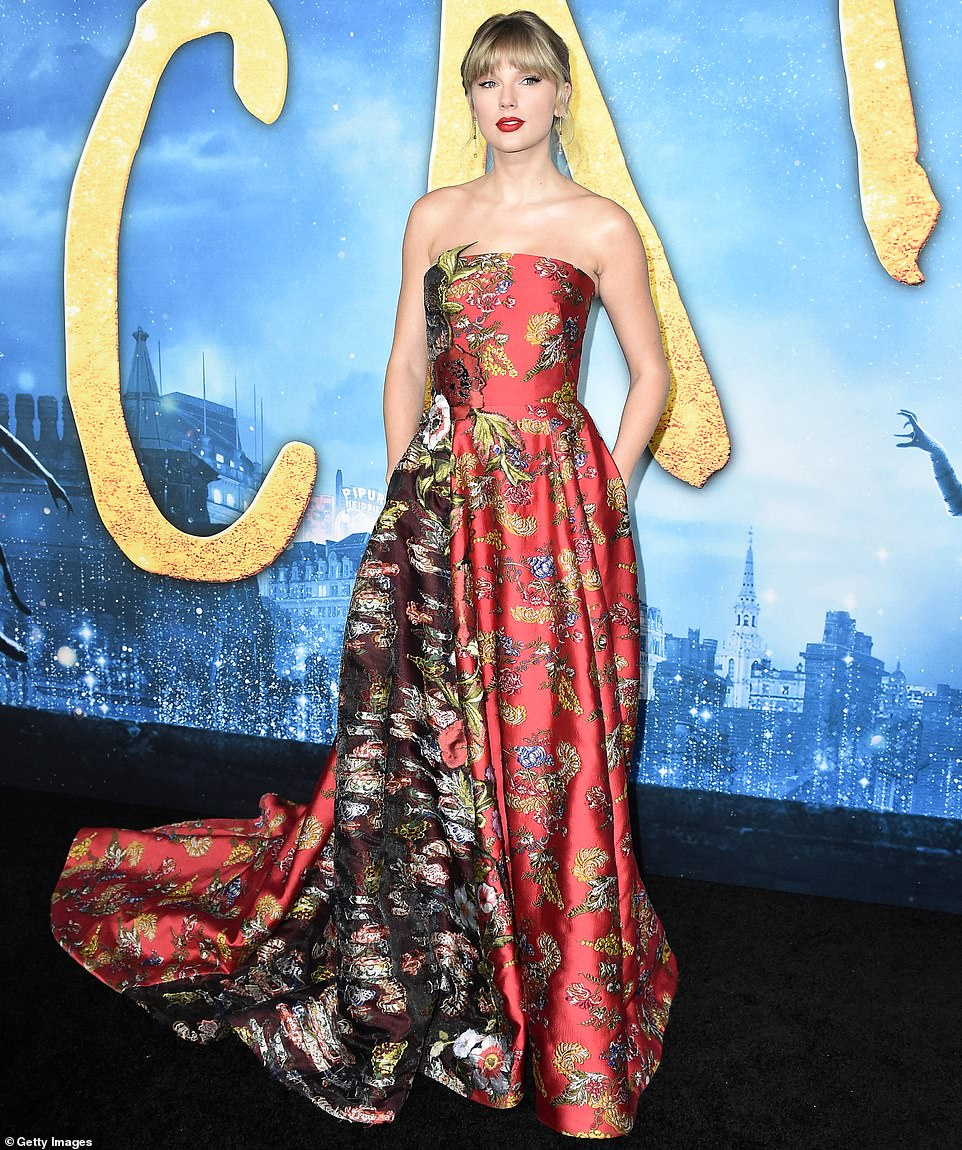 Taylor Swift dazzles in gorgeous red floral gown at the Cats premiere in New York City