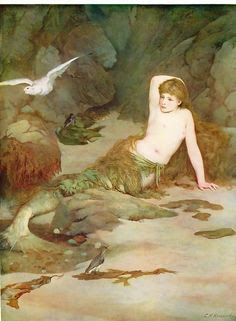 vintage merboy in cave with green fin