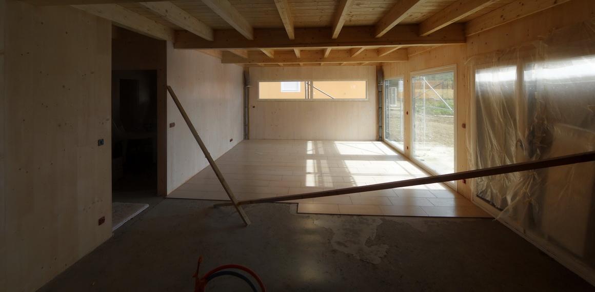 notre maison passive au pays des 3 fronti res lorraine la pose du carrelage dans le salon. Black Bedroom Furniture Sets. Home Design Ideas