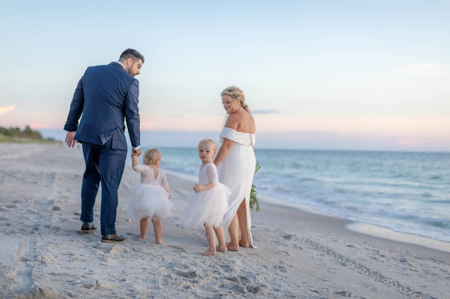 Beach portrait of bride and groom with kids